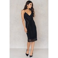 The Sen Dress by Aéryne for NA-KD features spaghetti shoulder straps