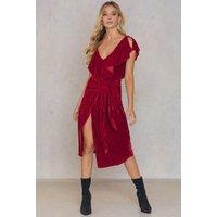 The Lexi Dress by Aeryne Paris features an off shoulder design