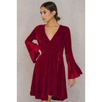 The Mave Dress by Aeryne Paris features a wrapped neckline and skirt