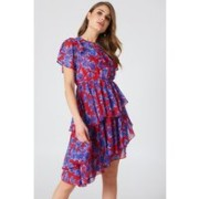 The Asymmetric Flounce Dress by NA-KD Boho features frill details