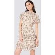 The High Neck Floral Ruffle Dress by Glamorous features a midi length