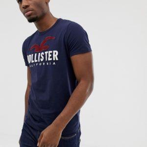 Hollister – Marineblaues T-Shirt mit aufgesticktem Möwenlogo auf der Brust – Navy